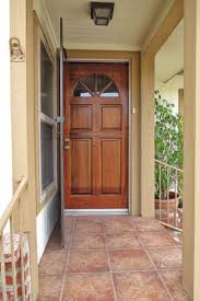Traditional Front Door with exterior tile floors