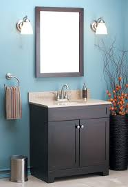popular cool bathroom color: an espresso brown vanity with matching mirror perfect for the modern bathroom http