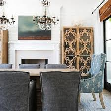 blond wood dining table with charcoal gray slipcovered dining chairs view full size gorgeous dining room features a pair of paris flea market chandelier