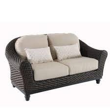 camden dark brown wicker outdoor loveseat with sunbrella antique beige cushions