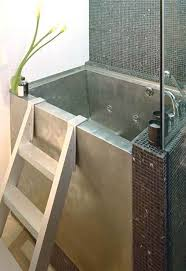 Small Modern Japanese Soaking Tub for Contemporary Bathroom -wooden cover  to use as shelf when
