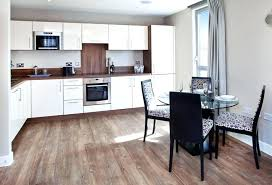 what are the pros and cons of wood flooring in kitchen tile floor versus ceramic