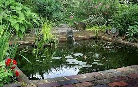 here s a square garden pond with fountain