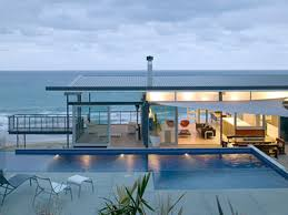 Okitu House by Pete Bossley Architects Inc. Okitu House, designed by Pete  Bossley is a contemporary beach house with stunning views and exceptional  design