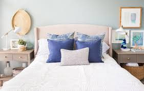 blue and white master bedroom with blue walls and blue and white bedding by making home