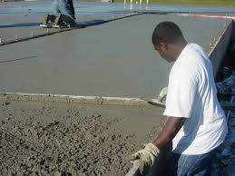 Placing and finishing concrete slab cap over fill within stem wall  foundation