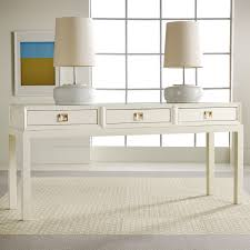 semi antique modern lacquer console table in white a couple of white table lamps with white