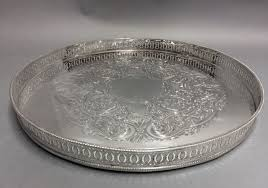 large round silver plated serving tray with fl decoration on the bottom so called gallery ca 1900