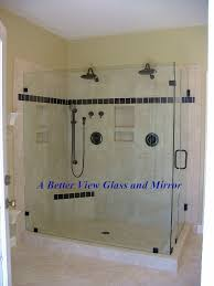 shower glass frameless door with large glass panel and small glass shower return panel installed with