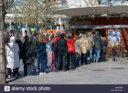 people queuing at fast track ticket booth at the london eye