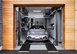 garage inside with car. Silver Porsche On 4 Post Car Lift Inside Residential Garage With I