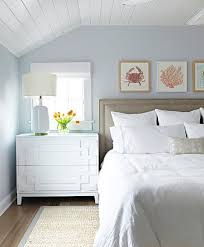 gray and blue beach bungalow bedroom with gray bound sisal rug