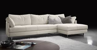 modern sectional sofas. Plain Sofas Sectional Modern Sofa White Colored Sofas Four Pillows And One Brown  Table Whites Fluffy Carpet At Inside