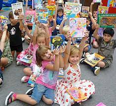kids with their new books at book fair