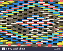 Colorful rubber doormats for sale outside shop Stock Photo: 11566496 ...