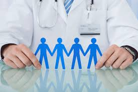 Image: Health practitioner holding paper people.