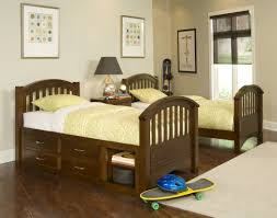kids twin beds with storage. Tall Children Twin Bed With Storage Drawers And Tiered Shelves Of From Bunk Beds That SeparateTwin Kids A