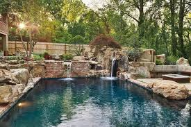 the waterfall is surrounded by dry stack stone walls a time consuming labor of love that requires fitting together stone of various shapes and sizes and