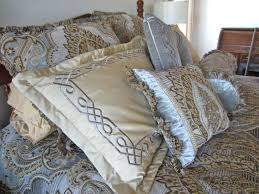 the striking wallpaper found in the claude room was the inspiration for this compelling bed ensemble
