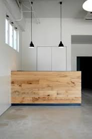 Create a Clean Image With Simple Style - In the modern home design world,  less is often more. This natural, simple reception desk sets the company  apart ...