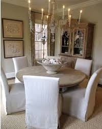 i love the slipcovered chairs with the round table my table is exactly like this one except it is black i may have to get covers for my chairs