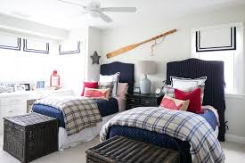red and blue nautical boys bedroom with shared nightstand