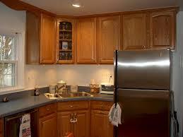 corner sink with corner cabinet and glass door above