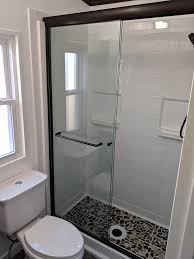 in a step in shower the curb is the part of the shower that keeps water in the shower or pan curb height is measured from the outside of the shower