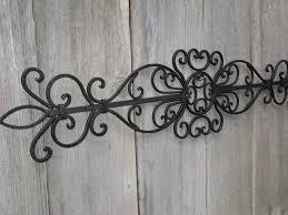 metal wall decor shop hobby: metal wall scroll with fleur de lis hobby lobby polyvore