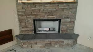 stacked stone fireplace and hearth