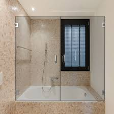 Bathroom tub swinging glass doors