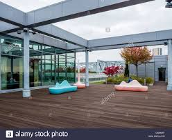 rooftop furniture. Rooftop Garden With Pink \u0026 Blue Modern Chairs And Shrubs Of The Designer Stilwerk Furniture Centre - Kant Street, Berlin