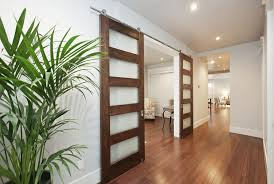 stylish interior barn door with glass and glass barn doors design glass barn doors ideas decoration