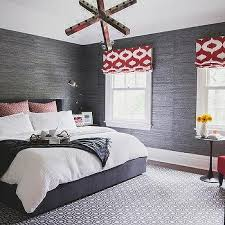 charcoal gray bedroom with red accents