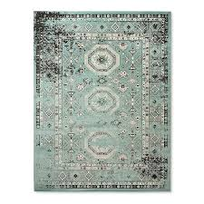 teal geometrical pattern overdyed rug