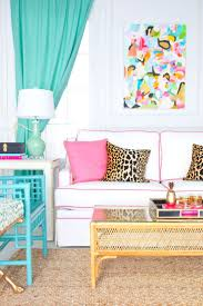 bright colored furniture. colorful living room with white sofa pink piping and turquoise bamboo chairs plus matching drapes love the mix of pillows leopard bright colored furniture