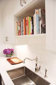 view in gallery bookshelf directly above kitchen sink