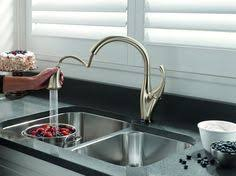 touch activated kitchen faucet top  touchless kitchen faucets the moen motion sense pull down kitchen