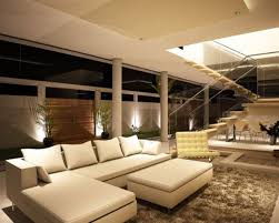 big living rooms. living room large space with dark brown walls and coral sofa big rooms