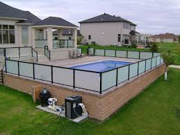 around swimming pool above ground pool with raise paver paio by oasis landscapes safety rail with privacy panels