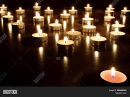 Prayers About Light And Darkness Round Tea Light Image Photo Free Trial Bigstock