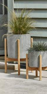 new two concrete standing planters