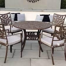 round cast aluminium leaf design table
