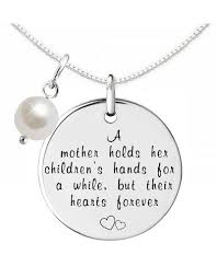 kaya jewellery silver necklace pearl a mother holds her children s