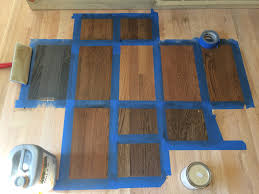 the crew stained a few diffe areas of the floor to see how diffe floor boards were taking the stain we love it bona hardwood stain