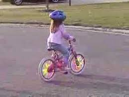 Image result for A little girl riding her bike
