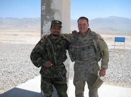 former navy intelligence specialist ron white with an afghanistan national army soldier during his deployment to navy intelligence specialist