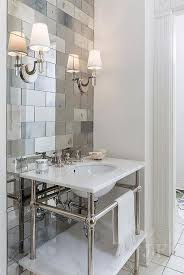 antiqued mirrored subway tiles with marble washstand