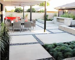 View in gallery Large concrete slab and pebble patio design