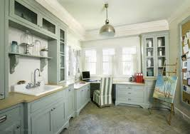 laundry office. delightful blue laundry room and office space with multiple windows beautiful industrial pendant hanging from the ceiling